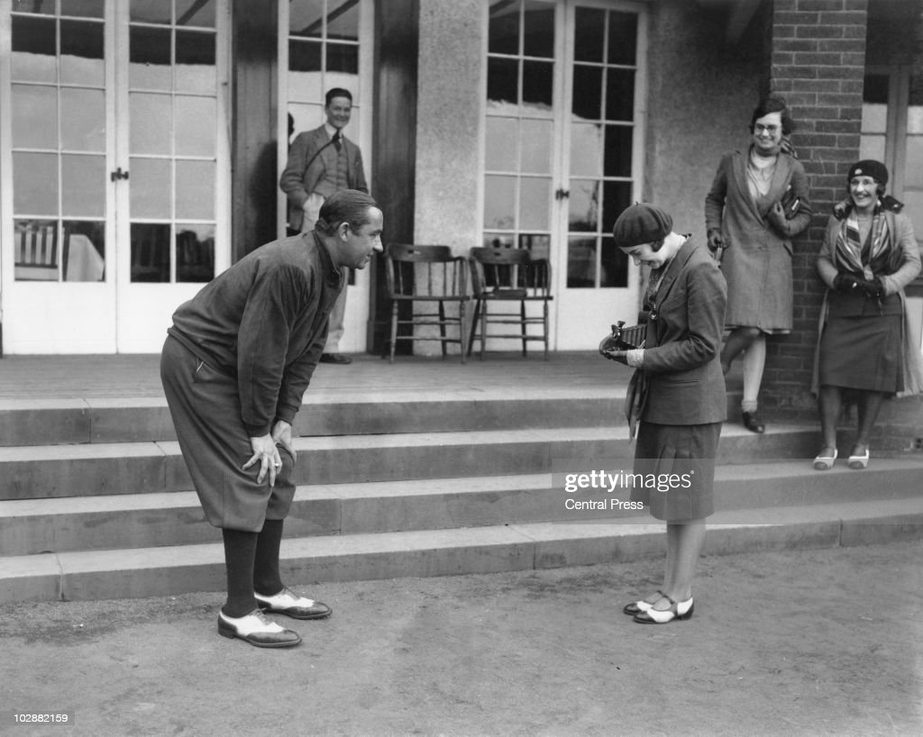 American captain Walter Hagen (1892 - 1969) has his photograph taken by a young lady during the Ryder Cup at Moortown Golf Club in West Yorkshire, April 1929.