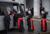 American Cardinals Sean P O'Malley Keith O'Brien and Timothy M Dolan board a bus to take them from the North American College to St Peter's Basilica...