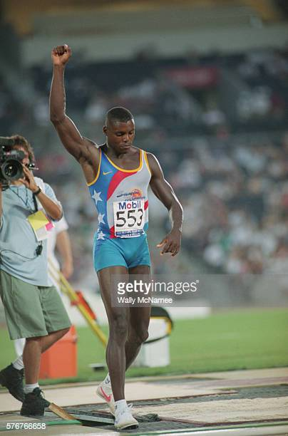 American Carl Lewis celebrates a good jump that puts him into the final of the men's long jump competition at the 1996 Olympic Trials in Atlanta...