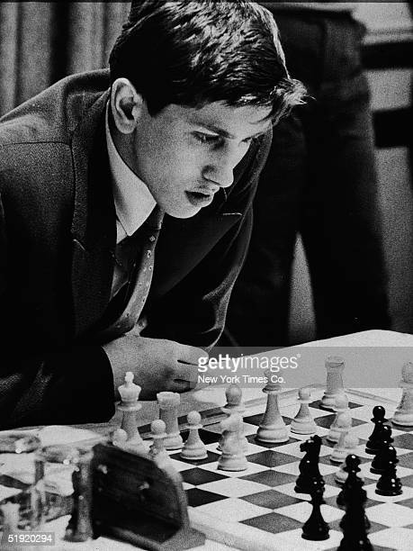 American chess champion and prodigy the controversial and tempermental Bobby Fischer wins the Frank J Marshall trophy at the National Chess...