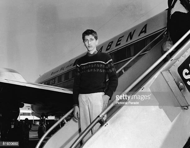 American chess champion and prodigy the controversial and tempermental Bobby Fischer exits the aircraft as he arrives home at Idlewild Airport after...