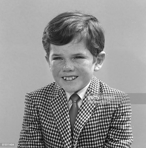 American child actor Butch Patrick wears a checked jacket and tie in this promotional portrait for the CBS television situation comedy 'The Munsters'...