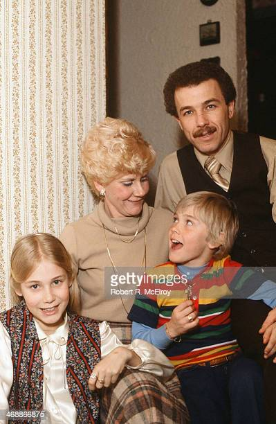 American child actor Ricky Schroder poses with his sister fellow actor Dawn Schroder and their parents at his ninth birthday party New York New York...
