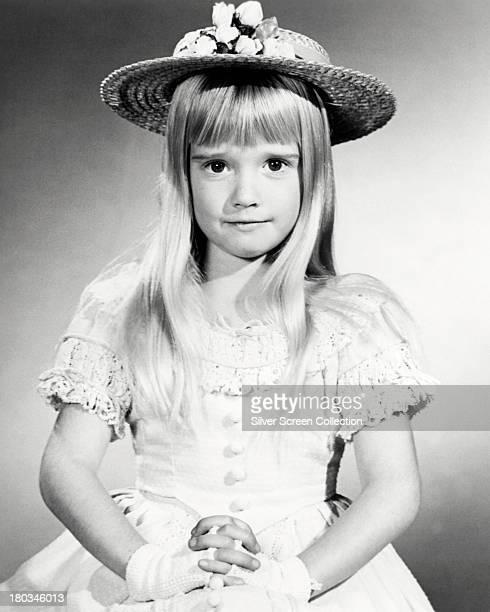 American child actress Kim Richards wearing a sun hat circa 1970