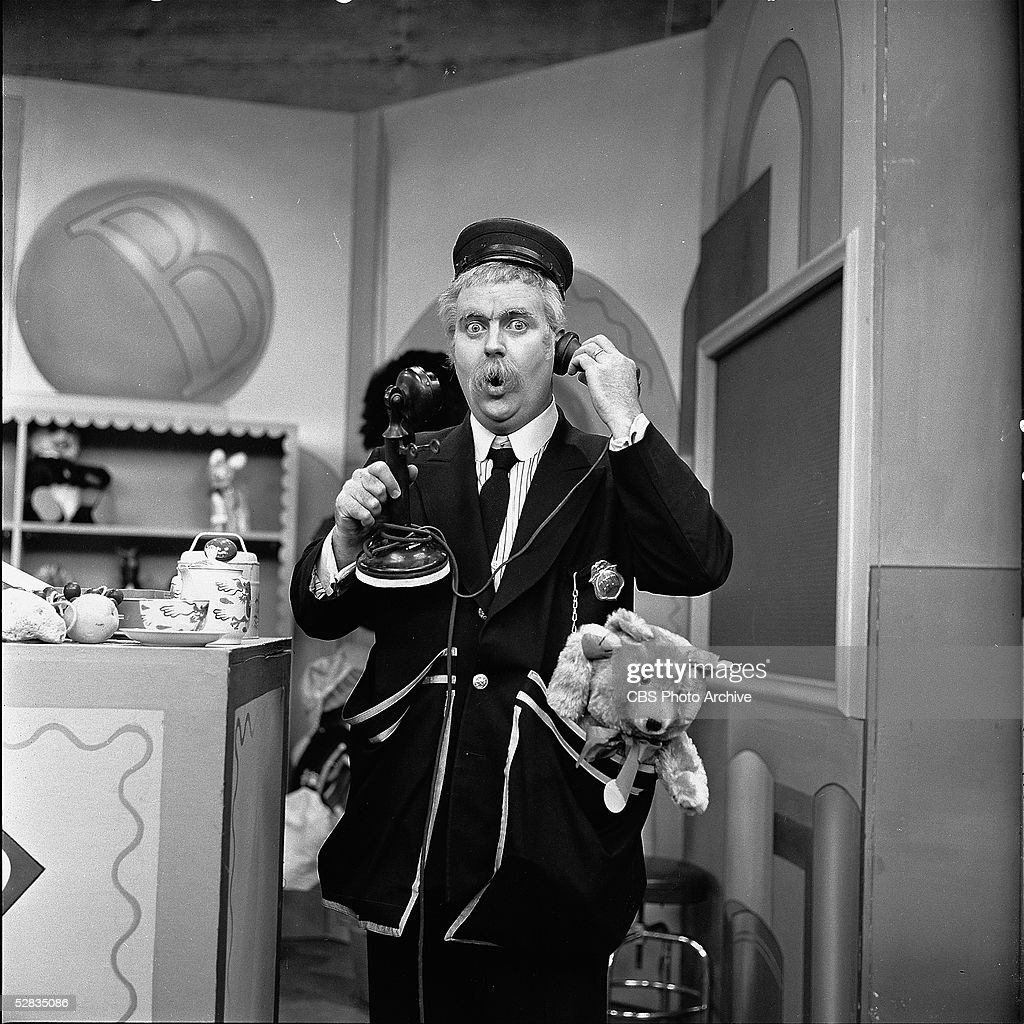 American children's entertainer and executive producer Robert Keeshan talks on an oldfashioned candlestick telephone in a still from the beloved...
