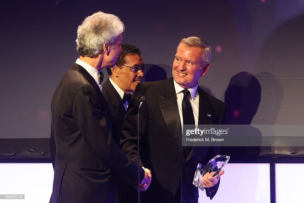 American Cinematheque Chairman Rick Nicita, American Cinematheque President Henry Shields Jr. and Honoree and Chicago International Film Festival Founder and Artistic Director Michael Kutza (holding Sydney Pollack Award) onstage during the 26th American Cinematheque Award Gala honoring Ben Stiller at The Beverly Hilton Hotel on November 15, 2012 in Beverly Hills, California.