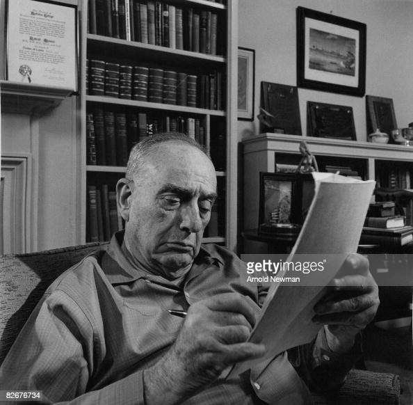 American city planner Robert Moses takes notes as he sits in his office New York New York April 8 1964