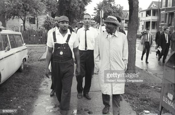 American Civil Rights activist Albert Raby head of Coordinating Council of Community Organizations and comedian and social activist Dick Gregory...