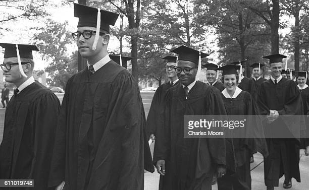 American Civil Rights activist and James Meredith walks with his University of Mississippi classmates during the school's graduation ceremony Oxford...