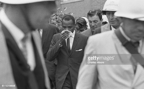 American Civil Rights activist and student James Meredith is escorted by Chief US Marshal James JP McShane an others on his way to register for...