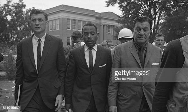 American Civil Rights activist and student James Meredith is escorted by Assistant Attorney General for Civil Rights John Doar and Chief US Marshal...