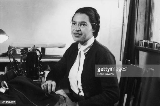 American Civil Rights activist Rosa Parks poses as she works as a seamstress shortly after the beginning of the Montgomery bus boycott Montgomery...