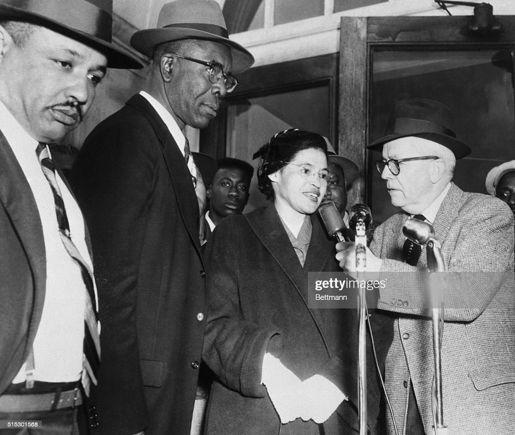 Rosa Parks speaks with an interviewer as she arrives at court with Reverend Edward Nixon and 91 other African Americans on trial for violation of a 1921 anti-boycott law. They were part of a city-wide boycott of buses by African Americans ignited by Rosa Parks' arrest for violation of the 'Jim Crow' Law forbidding African Americans from sitting with whites at the front of busses.