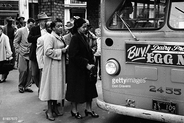 American Civil Rights activist Rosa Parks waits to board a bus at the end of the Montgomery bus boycott Montgomery Alabama December 26 1956