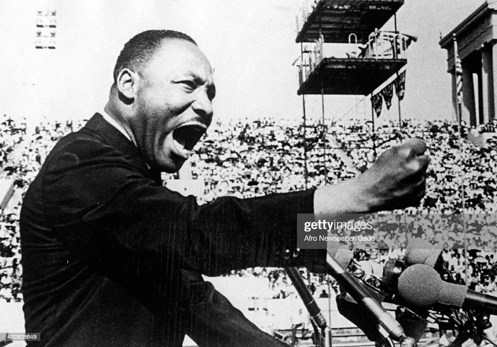 American Civil Rights and religious leader Dr <a gi-track='captionPersonalityLinkClicked' href=/galleries/search?phrase=Martin+Luther+King&family=editorial&specificpeople=70030 ng-click='$event.stopPropagation()'>Martin Luther King</a> Jr (1929 - 1968) gestures emphatically during a speech at a Chicago Freedom Movement rally in Soldier Field, Chicago, Illinois, July 10, 1966.