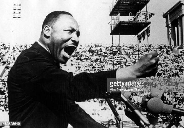 American Civil Rights and religious leader Dr Martin Luther King Jr gestures emphatically during a speech at a Chicago Freedom Movement rally in...