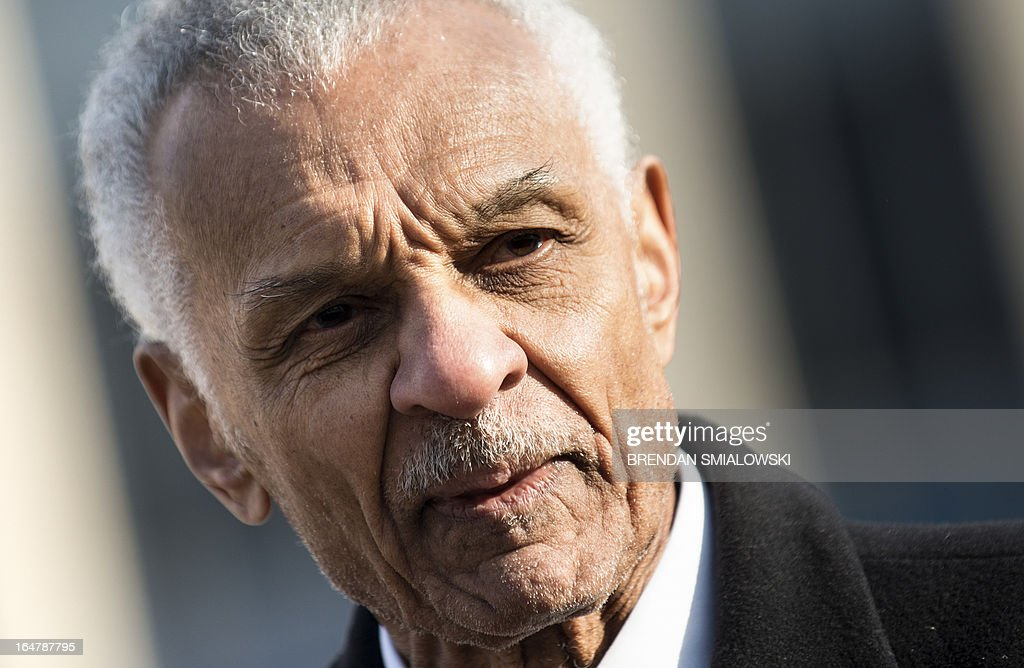 """American Civil Rights era icon Reverend C.T. Vivian arrives at the E. Barrett Prettyman Federal Courthouse March 28, 2013 in Washington, DC for the trial of former US Army Lt. Dan Choi(L), a gay rights activist and opponent of 'Don't ask Don't Tell'. The trial of Choi, which began in August 2011, resumes Thursday in federal court. The former Iraq War vet and graduate of West Point is going to trial to face charges that stem from a November 2010 arrest for chaining himself to the White House fence to protest """"Don't Ask, Don't Tell."""" AFP PHOTO/Brendan SMIALOWSKI"""