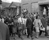 American Civil Rights leader Dr Martin Luther King Jr and his wife Coretta Scott King lead others during on the Selma to Montgomery marches held in...