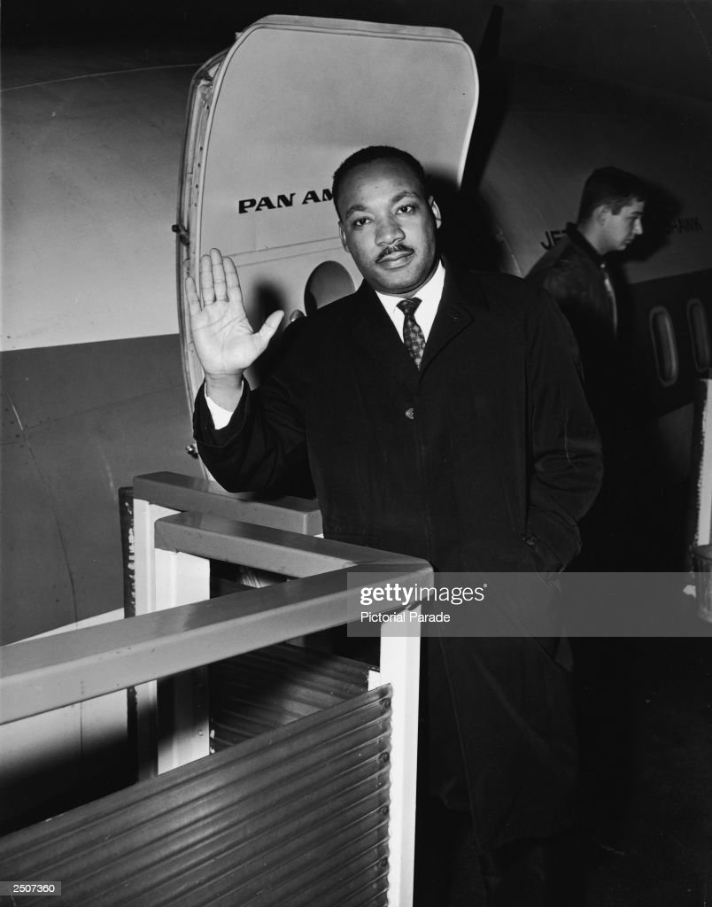 American civil rights leader Dr. Martin Luther King, Jr. (1929 - 1968) waves as he boards a Pan-Am airplane headed for Europe where he will give talks in Paris and London and receive an honorary degree in social science from the Free University of Holland at Amsterdam, New York City, New York, October 18, 1965.