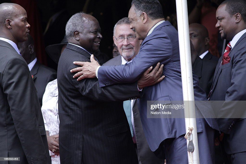 American civil rights leader, Reverend Jesse Jackson, welcomes outgoing President Mwai Kibaki at the Inauguration ceremony of President Uhuru Kenyatta on April 9, 2013 in Nairobi, Kenya. Kenyatta received masses of support from the citizens of Kenya despite being under investigation for crimes against humanity.
