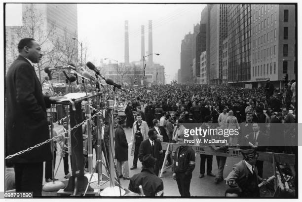 American Civil Rights leader Reverend Martin Luther King Jr speaks to a large crowd at the United Nations plaza after an antiVietnam war march New...