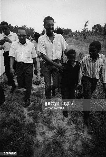 American Civil Rights leaders Dr Martin Luther King Jr and Trinidadianborn American Stokely Carmichael walk with others during a march to encourage...
