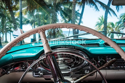 American Classic Car In Cuba With Interior And Beach View Stock Photo