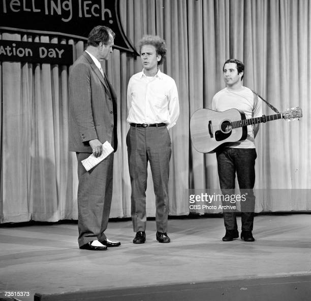 American clown actor and telelvsion host Red Skelton talks to folkpop musicians Art Garfunkel and Paul Simon of the duo Simon and Garfunkel on the...