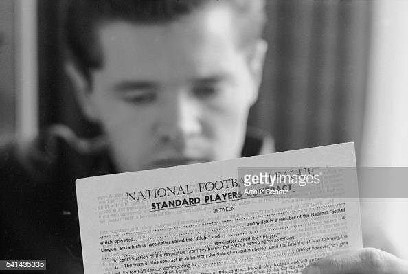 American college football player Gary Snook quarterback for the Univeristy of Iowa reviews an NFL draft contract Fullerton California 1965
