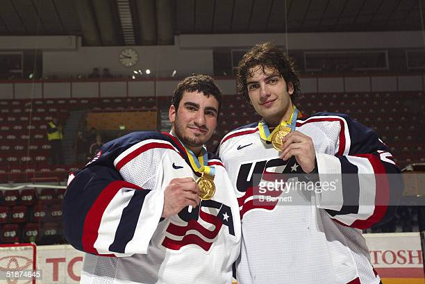 American collegiate ice hockey players goalies Dominic Vicari and Al Montoya show off their gold medals after the US team defeated the Canadians at...