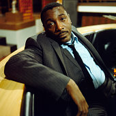 American comedian and actor Dick Gregory posed on the set of the television drama 'Armchair Theatre Neighbours' in 1966