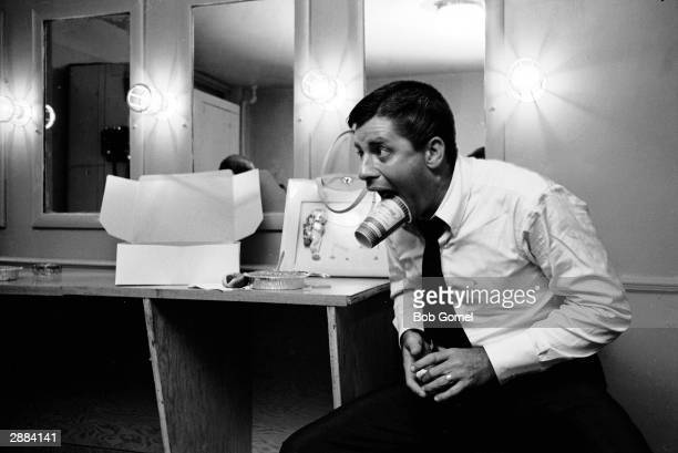 American comedian and actor Jerry Lewis plays around backstage at the Tilyou Theater Coney Island New York July 13 1961