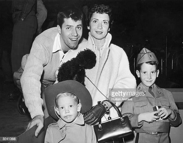 American comedian and actor Jerry Lewis poses with his wife Patti and his young sons Gary and Ron Gary is dressed in a Wolf Cub's uniform and Ron...