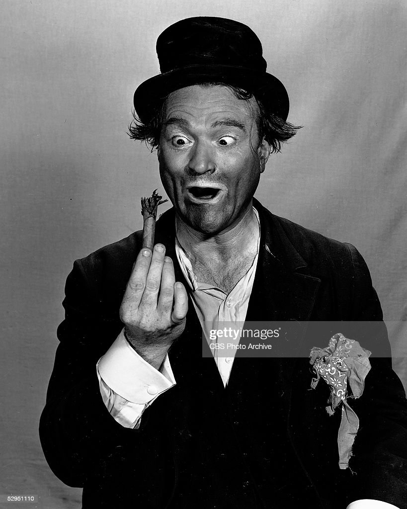 American comedian and actor Red Skelton looks wide-eyed at a broken cigar, dressed as Freddie the Freeloader, a recurring character from the televison variety series, 'The Red Skelton Show,' 1960s.