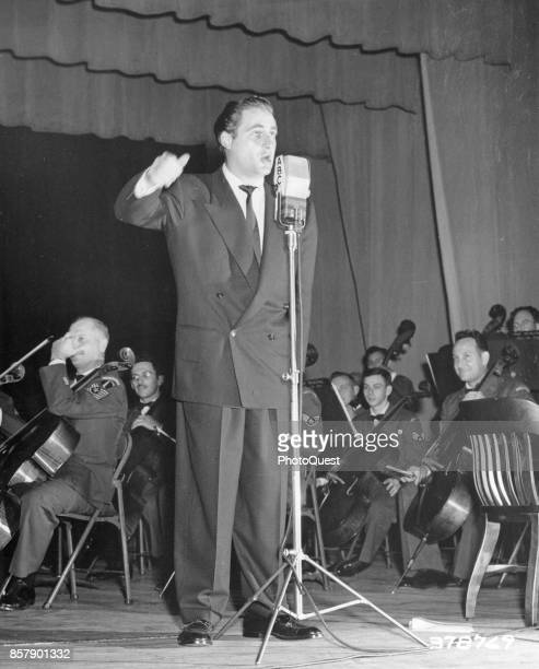 American comedian and actor Sid Caesar performs onstage for ABC television's 'Time for Defense' a weekly entertainment and documentary show...