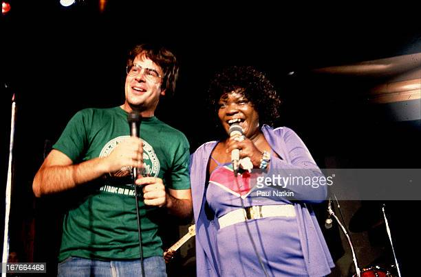 American comedian and singer Dan Aykroyd and blues singer Koko Taylor perform together on stage Chicago Illinois October 19 1982