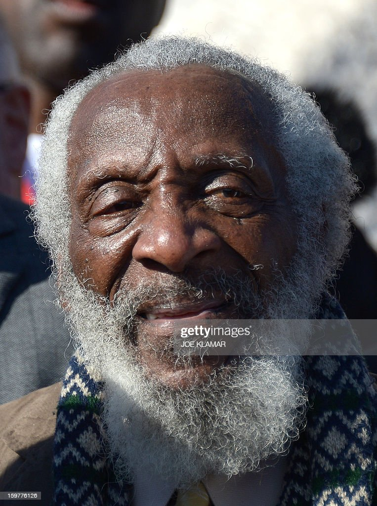 American comedian and social activist Dick Gregory attends a Martin Luther King Day ceremony under the statue of civil rights leader Martin Luther King, Jr. at the MLK Memorial on January 20, 2013 in Washington. King is best known for his role in the advancement of civil rights using nonviolent civil disobedience.