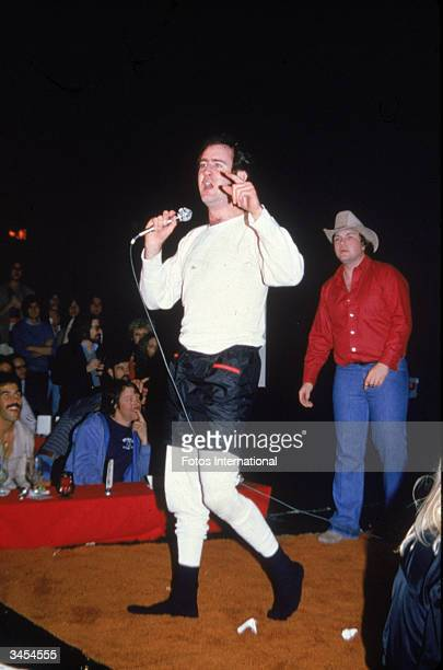 American comedian Andy Kaufman gestures while performing his wrestling act at The Comedy Store nightclub December 1979