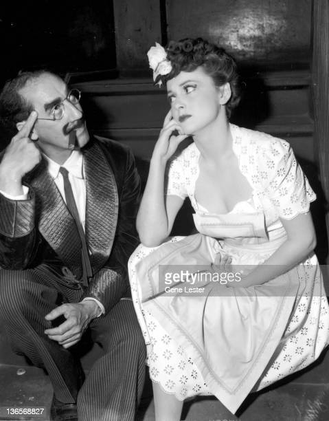 American comedian Groucho Marx with actress Olivia de Havilland during their tour with the Hollywood Victory Caravan USA 16th May 1942 The tour took...