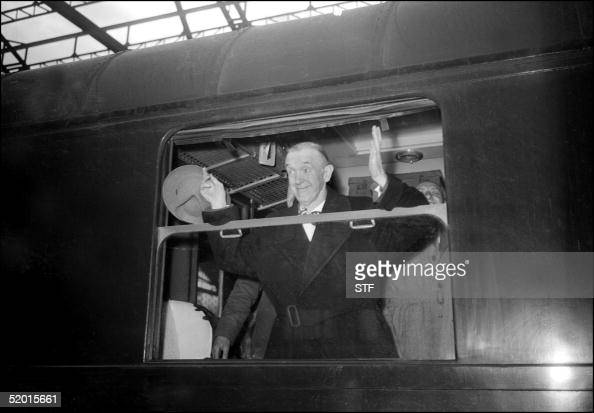 American comedian Stan Laurel shown in a file photo dated 13 April 1950 waving from a train at the SaintLazare train station in Paris