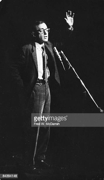 American comedian Woody Allen performs a standup routine at the Gaslight Cafe a coffee house and nightclub in Greenwich Village New York New York...