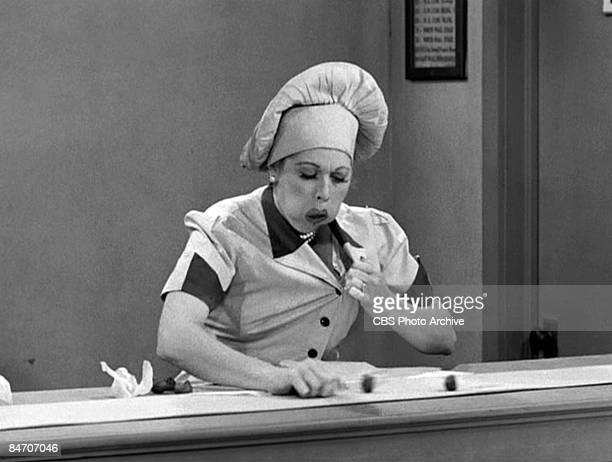 American comedienne and actress Lucille Ball as Lucy Ricardo work at a candy factory conveyor belt on an episode of the television comedy 'I Love...