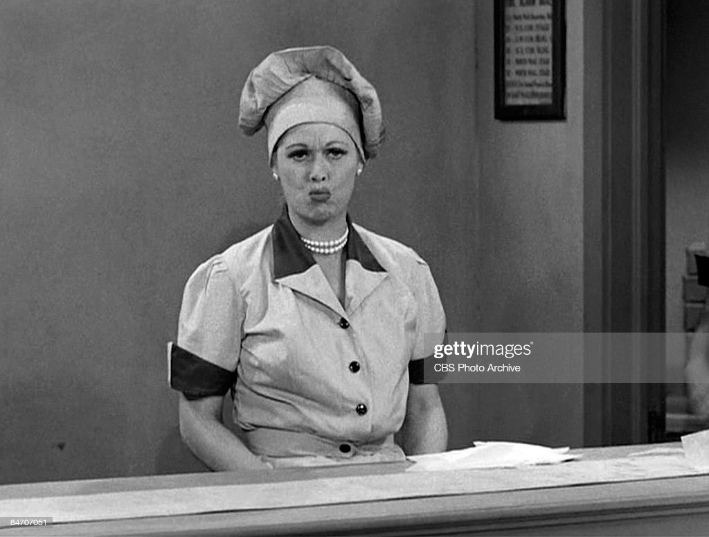 American comedienne and actress <a gi-track='captionPersonalityLinkClicked' href=/galleries/search?phrase=Lucille+Ball&family=editorial&specificpeople=70020 ng-click='$event.stopPropagation()'>Lucille Ball</a> (1911 - 1989), as Lucy Ricardo, work at a candy factory conveyor belt on an episode of the television comedy 'I Love Lucy' entitled 'Job Switching,' Los Angeles, California, May 30, 1952. The episode was originally broadcast as the opening episode of the show's second season, on September 15, 1952.