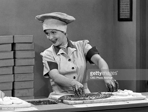 American comedienne and actress Lucille Ball as Lucy Ricardo works in a candy factory on an episode of the television comedy 'I Love Lucy' entitled...