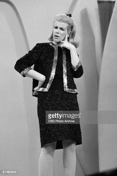 American comedienne Joan Rivers strikes a puzzled pose while performing her act on 'The Ed Sullivan Show' New York New York December 12 1966