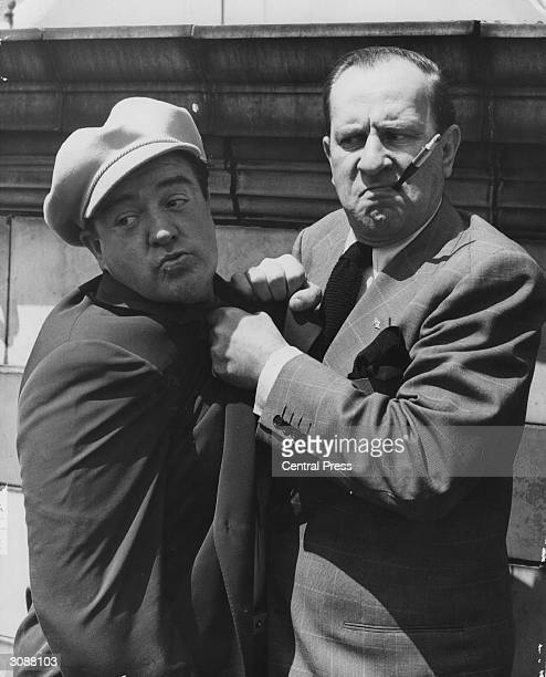 American comedy duo Bud Abbott and Lou Costello who starred in over 35 films together during a visit to England