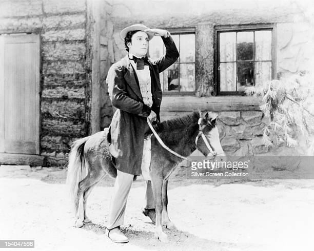 American comic actor and filmmaker Buster Keaton astride a diminutive pony as Willie McKay in 'Our Hospitality' 1923 The film was written produced...