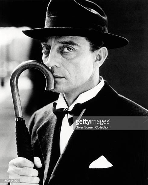 American comic actor and filmmaker Buster Keaton holding an umbrella 1932