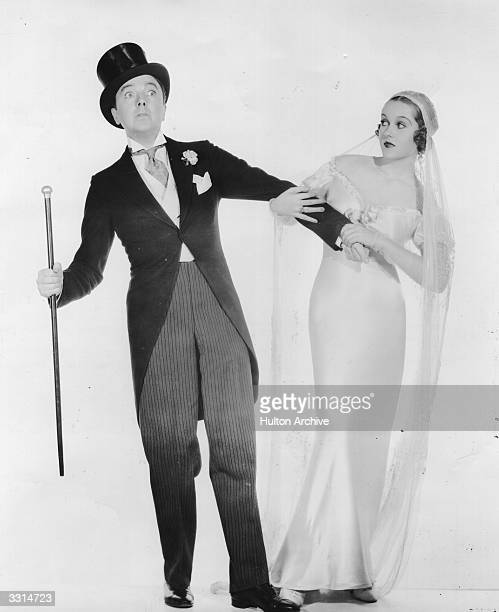 American comic actor Jack Haley plays the part of a reluctant groom to Patricia Ellis's insistent bride in the gangster comedy 'Here Comes the Groom'...