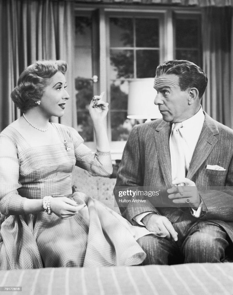 American comic actors Gracie Allen and George Burns in a scene from their TV series 'The George Burns and Gracie Allen Show' circa 1955